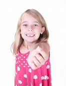 foto of tooth-fairy  - Little girl in red dress showing her first loose tooth - JPG