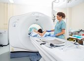stock photo of cat-scan  - Nurse preparing patient for CT scan in hospital room - JPG