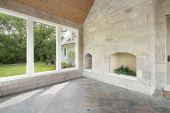 stock photo of screen-porch  - Stone porch in new construction home with fireplace - JPG