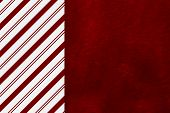 stock photo of candy cane border  - Candy Cane Striped and Red Plush Fabric Christmas Background with center copy - JPG