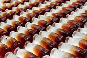 image of coca-cola  - Cola bottle background concept great for manufacturing or factories - JPG