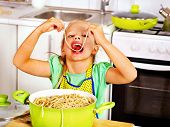 pic of pinafore  - Children  eating spaghetti at kitchen - JPG