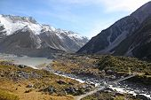 stock photo of hookers  - The swing bridge acrross the Hooker river and Valley in New Zealand - JPG