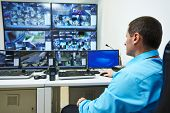 picture of cctv  - security guard watching video monitoring surveillance security system - JPG