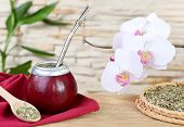 stock photo of calabash  - Tea mate in the calabash and orchid on stone wall background - JPG