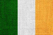 stock photo of irish flag  - flag of Ireland or Irish banner on linen background - JPG