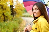 picture of girl walking away  - Woman happy with umbrella under the rain during Autumn forest walk - JPG