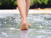 foto of footprint  - Girl walking on sand beach leaving footprints - JPG