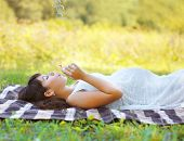 image of fetus  - Pregnant lovely woman resting in summer day - JPG