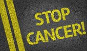 stock photo of colitis  - Stop Cancer written on the road - JPG