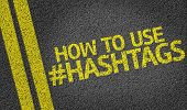 stock photo of hashtag  - How To Use Hashtags written on the road - JPG