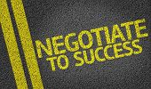 pic of negotiating  - Negotiate to Success written on the road - JPG
