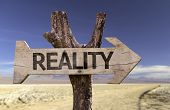 foto of realism  - Reality wooden sign with a desert background - JPG