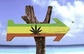 stock photo of rastafari  - Rasta Flag With Marijuana Leaf sign with a beach on background  - JPG
