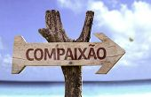 "picture of compassion  - ""Compaixao"" (In portuguese: Compassion) sign with a beach on background  - JPG"