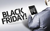 pic of friday  - Business man with the text Black Friday in a concept image - JPG