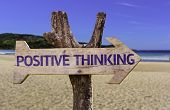 pic of think positive  - Positive Thinking wooden sign with a beach on background - JPG