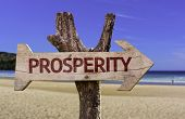 pic of prosperity sign  - Prosperity wooden sign with a beach on background - JPG