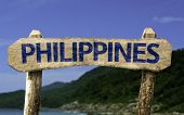 image of cebu  - Philippines wooden sign with a beach on background - JPG