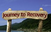 stock photo of persistence  - Journey to Recovery wooden sign with a beach on background - JPG