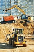 image of boom-truck  - wheel loader and excavator machine loading dumper truck at construction area sand quarry - JPG