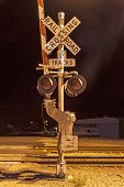 picture of railroad-sign  - Railroad crossing by night with sign in kingman - JPG