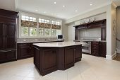 picture of kitchen appliance  - Kitchen in luxury home with cherry wood cabinetry - JPG