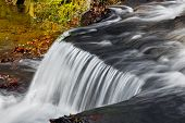 foto of cataracts  - Water flows over a jagged rock ledge of Clinton Falls a waterfall in rural Putnam County Indiana - JPG