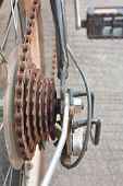 stock photo of bicycle gear  - rusty gear chain of bicycle close up
