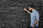 stock photo of formulas  - Bearded man draws formulas on a chalkboard - JPG
