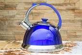 picture of boiling water  - Beautiful and comfortable bright blue kettle with a signal of boiling water in the form of a whistle - JPG