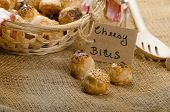 picture of love bite  - Cheesy bites with seeds wine in wicker basket nice gift - JPG