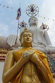 stock photo of buddha  - Gold buddha statue with white buddha statue background - JPG