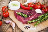 pic of beef shank  - Fresh beef steak with spices vegetables and sauce on a wooden background - JPG