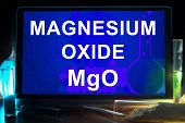 stock photo of oxidation  - Tablet with chemical formula of  magnesium oxide - JPG