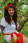 pic of national costume  - Ukrainian woman in national costume in a tree - JPG