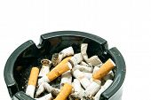 pic of butts  - butts in black ashtray on white background closeup - JPG