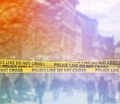 image of crime scene  - Police Line Do Not Cross Yellow Headband Tape Crime Scene on the Street - JPG