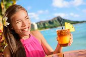stock photo of hawaiian girl  - Beach bar party drinking friends toasting Hawaiian sunset cocktails having fun - JPG