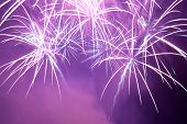 pic of firework display  - Blue and purple colorful fireworks on the black sky background - JPG