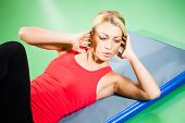 picture of crunch  - Young woman exercising in gym - JPG