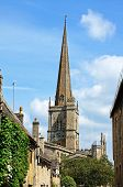 image of church-of-england  - St John the Baptist church seen from the High Street Burford Oxfordshire England UK Western Europe - JPG