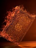 stock photo of warlock  - Leather Book in flames With Pentagram - JPG