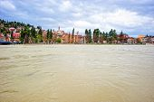 stock photo of flood  - Small Mediterranean town along the swollen river and threatening flood - JPG