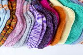 stock photo of thrift store  - a row of multicolored hand - JPG