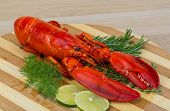image of lobster tail  - Boiled lobster served with thyme and rosemary - JPG