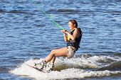 pic of watersports  - Woman study riding on a wakeboard outdoors - JPG