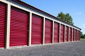 foto of self-storage  - A row of mini rental units for temporary self storage in an outdoor setting - JPG