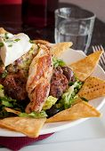 foto of nachos  - Close up of a healthy and nutritious meal of Mexican nachos with grilled chicken fillets - JPG