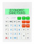 pic of macroeconomics  - Calculator with ECONOMIC SANCTIONS on display isolated on white background - JPG